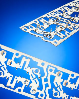 Custom electrical stampings engineered and produced by ETCO to speed manufacturing.